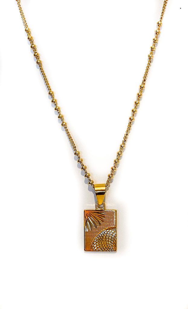 Gold tag Brilliance Necklace by Meghan Bo Designs.