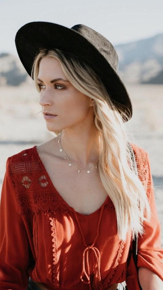 A blonde woman wearing a Vici Collection dress and Meghan BO Designs moon and stars Celestial Choker necklace.