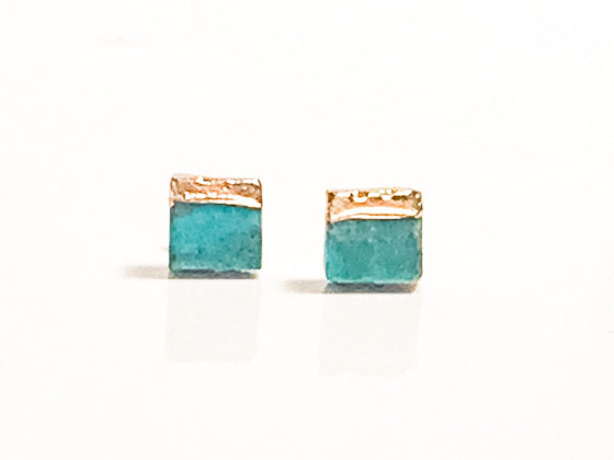 Turquoise square stud earrings with one side dipped in gold.