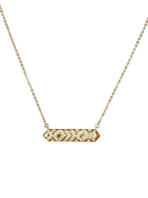 A rectangle pendant with cubic zirconia detail made by Meghan Bo Designs is on a delicate gold fill chain.