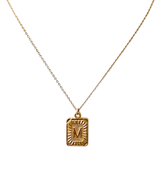 "Rectangle initial pendant in gold ""M"" initial made by Meghan Bo Designs."