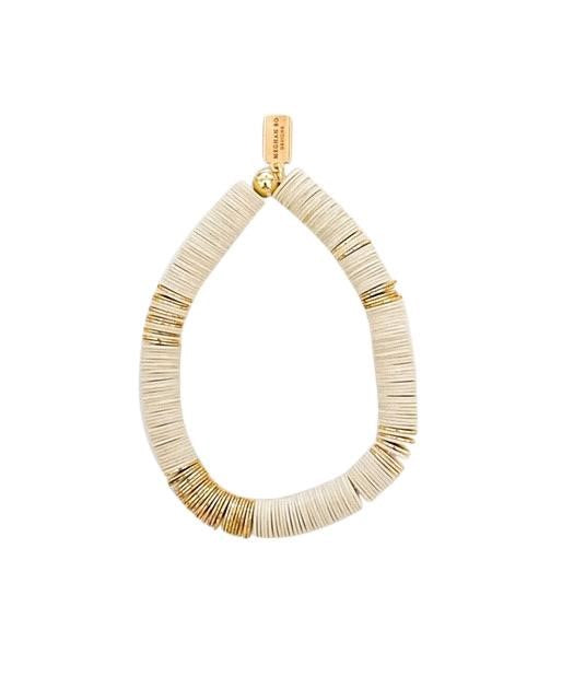 Ivory and gold heishi beaded stretch bracelet made by Meghan Bo Designs.