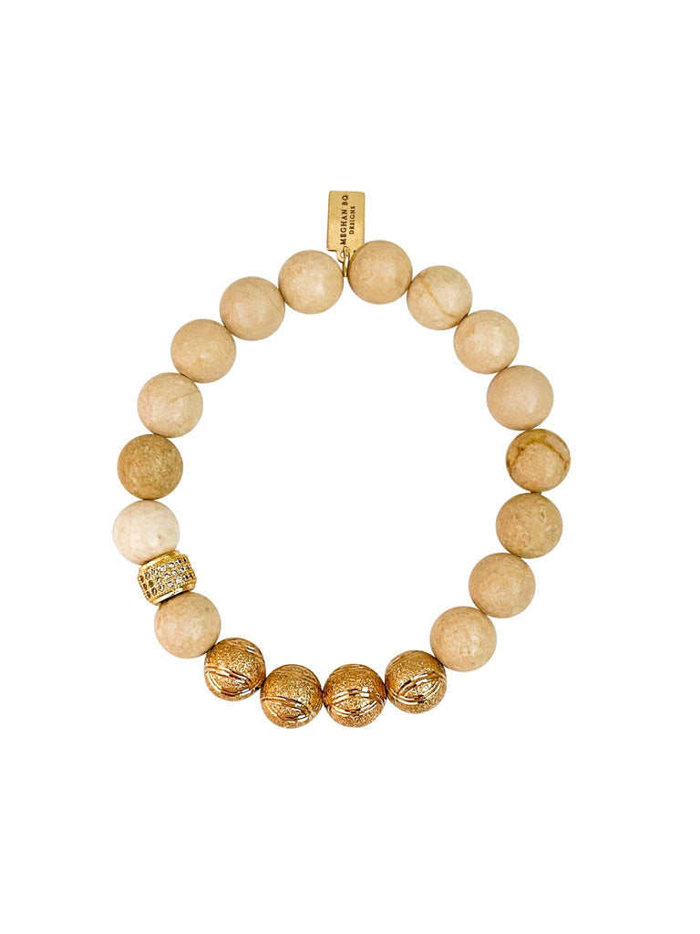 Ivory colored beads with gold fill accents and cubic zirconia made by Meghan Bo Designs.