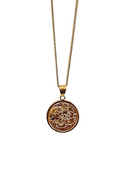 A long gold chain has a gold coin pendant with a dragon on it made by Meghan Bo Designs.