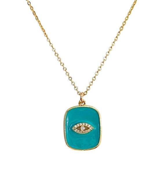 A gold chain necklace has a square turquoise enamel pendant with a cubic zirconia evil eye on it made by Meghan Bo Designs.