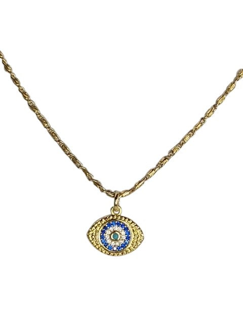 A gold chain with a small evil eye pendant that has cubic zirconia detail made by Meghan Bo Designs lays on a flat white surface.
