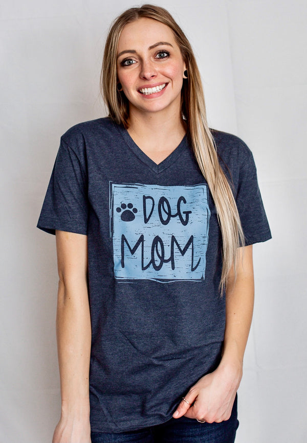 A short sleeve unisex Midnight Navy V-neck tee with DOG MOM graphic and paw print on front. Additional paw prints on back of shirt.