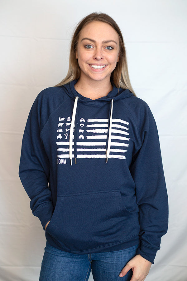 A midnight hooded sweatshirt with front pouch in Cool Blue color. Front graphic shows barns, tractors, silos, animals on a flag styled white graphic.