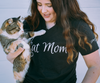 A Black unisex V-neck tee with a cute Cat Mom graphic in white ink.