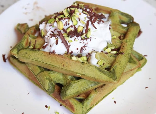Super moist and earthly Matcha Green Tea Waffles topped with coconut whipped cream & vegan chocolate for the relaxing weekend