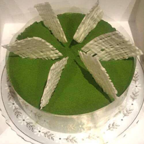 Whole matcha adzuki mousse cake topped with white chocolate decoration. Simple and delicious recipe