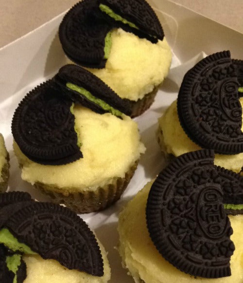 Buttercream frosting matcha cupcakes topped with matcha green tea oreos