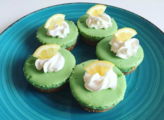 Sweet delicious Mini Matcha Cheesecake topped with light whipping cream and lemon slice topping