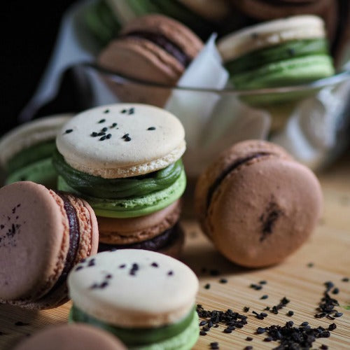 Matcha Green Tea Macarons with matcha cream filling and black sesame square crunch