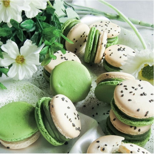 bi colored Macaron shells filled with matcha green tea white chocolate cream and black sesame square crunch