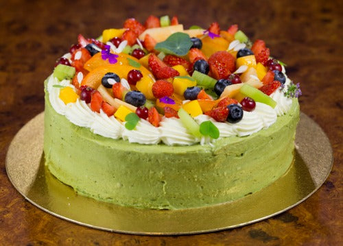 Green Tea Matcha Fruit Cake recipe with green tea fluffy light cake coated with creamy luscious matcha cream and topped with mixed fresh fruits, kiwi, strawberries, blueberries, mangos and cheries