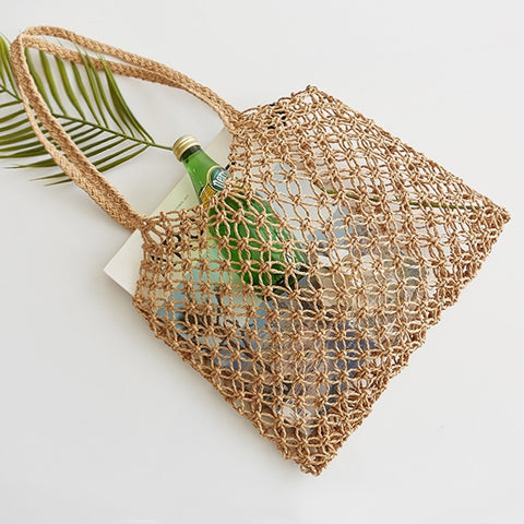 New hand-woven hollowwork straw bag paper rope grid without lining woven beach bag - Vietees Shop Online