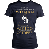 Never Underestimate a Woman who loves Aikido and was born in October Hoodied T-shirt - Vietees Shop Online
