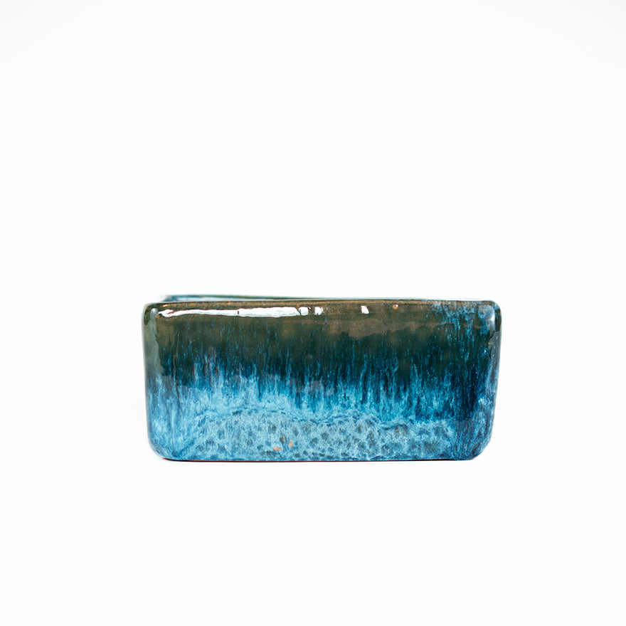 Side photo of small blue glazed square dish planter sold at Bear Valley Nursery