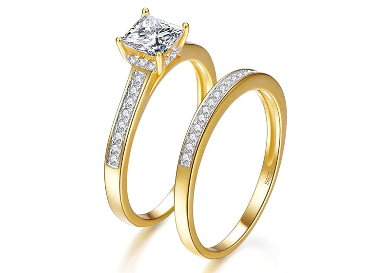 2 gold engagement rings with a 925 marking inside the ring
