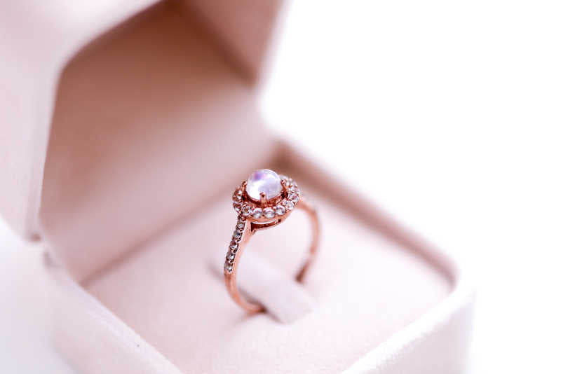 Moonstone and pink gold diamond ring in jewelry box