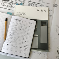 Image of Chequer A5 notebook being used to plan a new bathroom