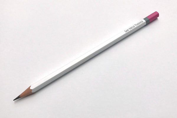 Image of a Say Nice Things pencil with white barrel and pink/grey tip.