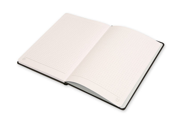 Angled view of Curtis A5 Notebook open on grid pages to show lay flat binding