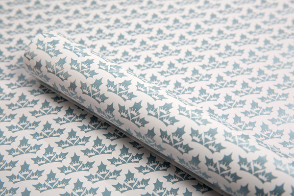Close up image of Holly Wears The Crown Christmas Wrapping paper design