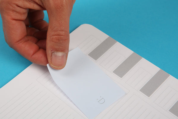 Image showing the Essentials notespod sticky notes being used in an Essentials notebook