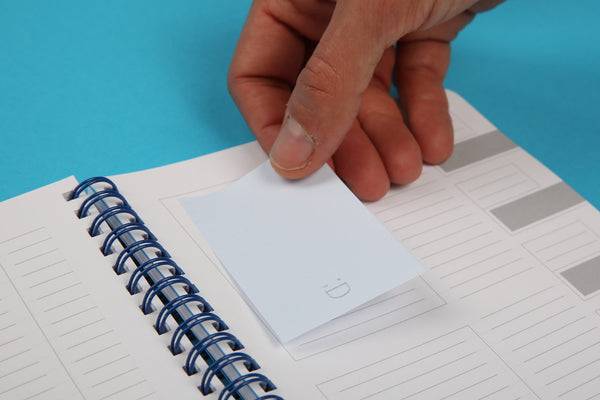 Image of small sticky note from Essentials notespod being used in Essentials A5 notebook