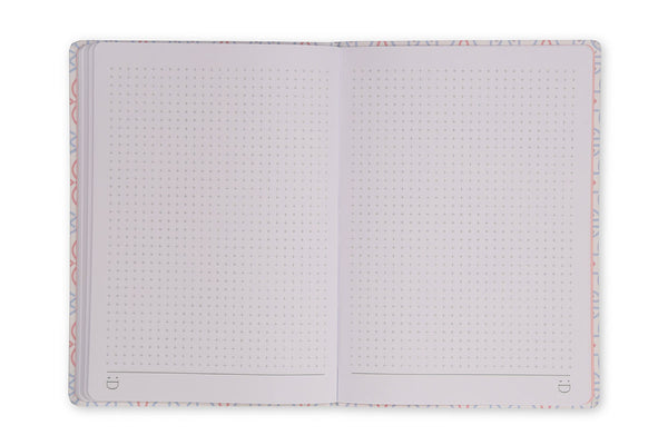 Image of Celtic A5 Notebook open showing lay flat binding and grid page design