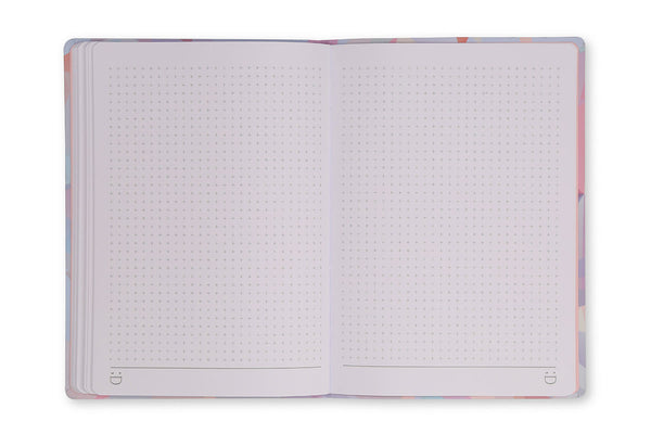Image of Crystal A5 Notebook open to show grid page design and lay flat binding