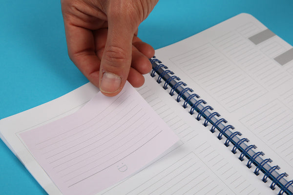Image showing large sticky note being positioned on A4 Essentials candy notebook page