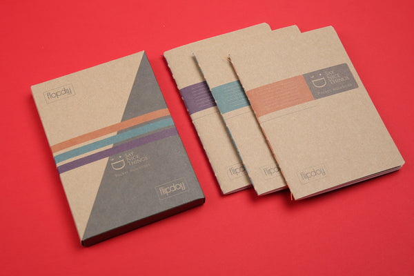 Image showing FlipFlop A6 pocket notebooks 3 pack on red surface