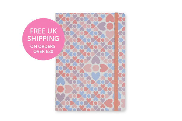 Image of Clover A5 Notebook cover showing heart design and pink elastic closure