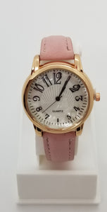 Gold base metal fashion watch with large numbers and pink leather strap