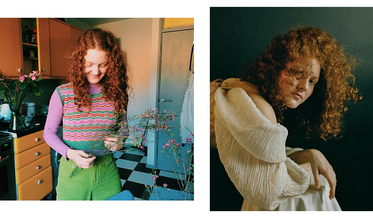 Woman in striped top with red curly hair.