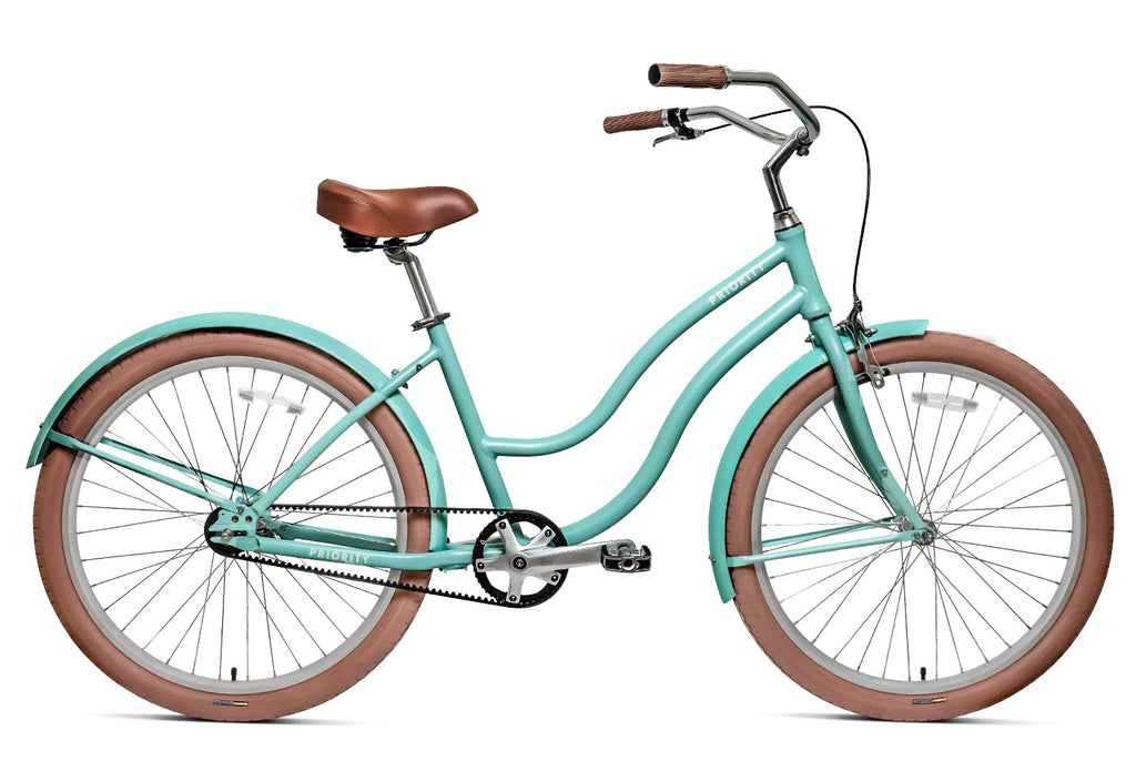 green/cyan women's cruiser bike with belt drive