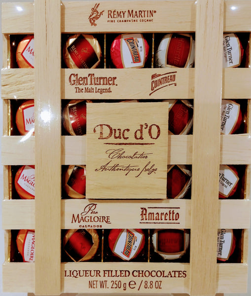 Duc d'O liqueur chocolates in a wooden crate 250g