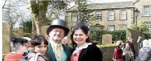 A 'Victorian family' posing outside the Brontë Parsonage