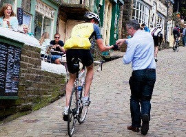 Handing out a chocolate sample to a cyclist ahead of the Tour de France in 2014