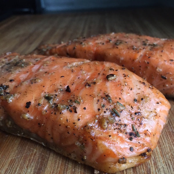 Roasted salmon is perfectly seasoned with seasoned salt and cracked black pepper.