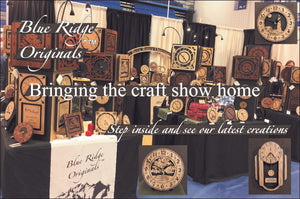 "A wide shot of our craft show booth of clocks, with the words, ""Blue Ridge Originals. Bringing the craft show home. Step inside and see our latest creations."""