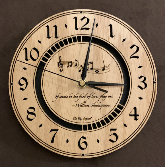 Round oak clock with music notes and the words,