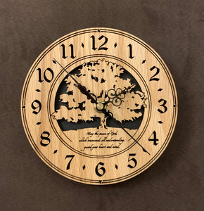 "Round Oak clock with a tree and the words,""May the Peace of God, which transcends all understanding, guard your heart and mind"" lasered in the face - 8"" on easel"