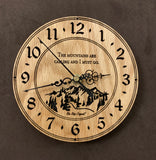 "Round oak clock with a mountain and the words, ""The mountains are calling and I must go"" lasered in the face - 6.5"" size"
