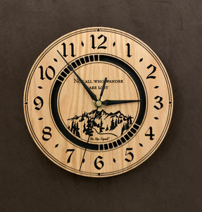 "Round Oak clock with a mountain and the words, ""Not all who wander are lost"" lasered in the face - larger sizes"