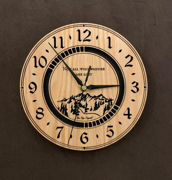 Round Oak clock with a mountain and the words,