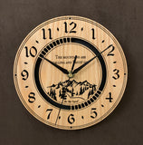 "Round oak clock with a mountain and the words, ""The mountains are calling and I must go"" lasered in the face - larger sizes"